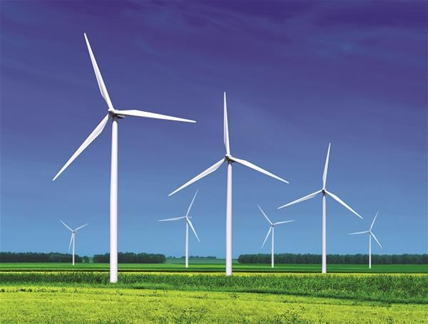 Several windmill on green field producing wind power